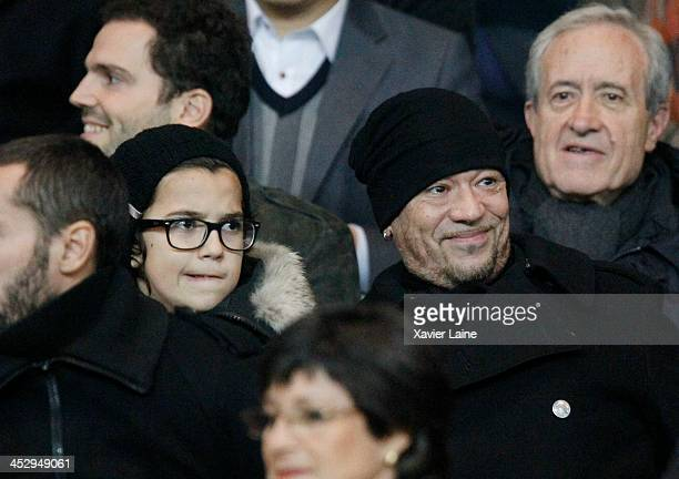 Pascal Obispo and his son attend the French Ligue 1 between Paris SaintGermain FC and Olympique Lyonnais at Parc Des Princes on December 1 2013 in...