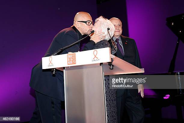 Pascal Obispo Line Renaud and Pierre Berge attend the Sidaction Gala Dinner 2015 at Pavillon d'Armenonville on January 29 2015 in Paris France