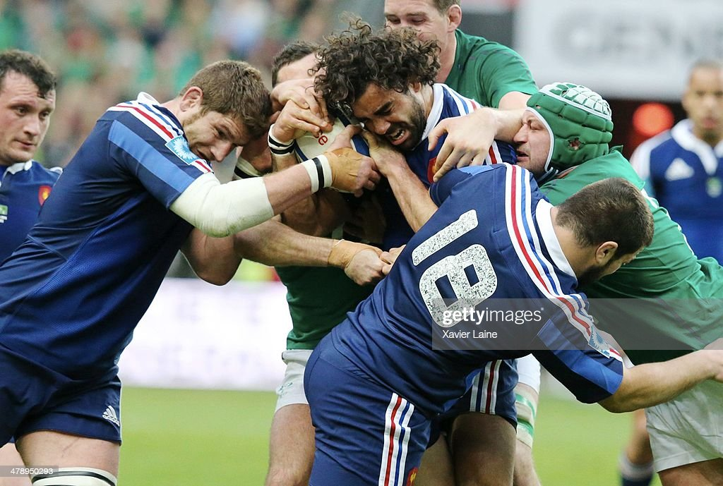 Pascal Pape and Yoann Huget of France with the ball during the RBS 6 Nations match between France and Ireland at Stade de France on march 15, 2014 in Paris, France.
