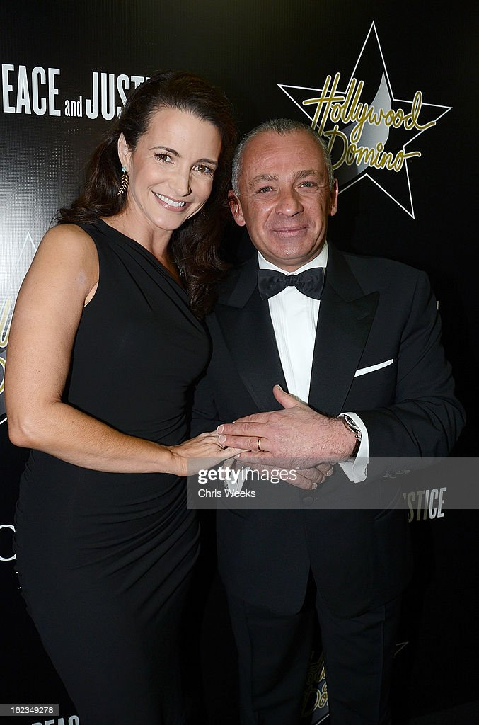 Pascal Raffy of Bovet and actress <a gi-track='captionPersonalityLinkClicked' href=/galleries/search?phrase=Kristin+Davis&family=editorial&specificpeople=202097 ng-click='$event.stopPropagation()'>Kristin Davis</a> attend the Hollywood Domino and Bovet 1822 Gala benefiting Artists For Peace And Justice at Sunset Tower on February 21, 2013 in West Hollywood, California.