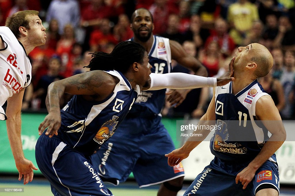 Pascal Roller (R) of Frankfurt is hit by team mate Aubrey Reese during game four of the Beko Basketball Bundesliga play off finals between Deutsche Bank Skyliners and Eisbaeren Bremerhaven at the Ballsporthalle on June 15, 2010 in Frankfurt am Main, Germany.