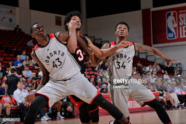 Pascal Siakam and Alfonzo McKinnie of the Toronto Raptors wait for a rebound during the 2017 Las Vegas Summer League game against the Portland Trail...