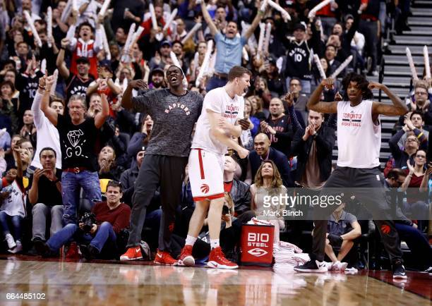 Pascal Siakam Jakob Poeltl and Lucas Nogueira of the Toronto Raptors celebrate during the game against the Charlotte Hornets on March 29 2017 at the...