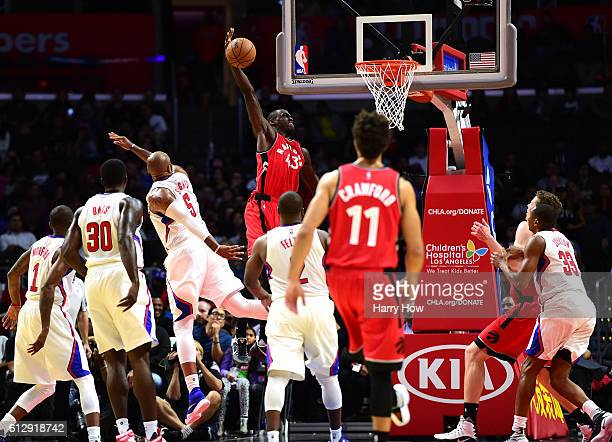 Pascal Siakam of the Toronto Raptors attempts a dunk as he is fouled by Marreese Speights of the Los Angeles Clippers during a preseason game at...