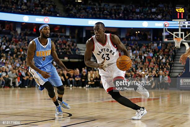 Pascal Siakam of the Toronto Raptors handles the ball against the Denver Nuggets on October 3 2016 at the Scotiabank Saddledome in Calagary Alberta...