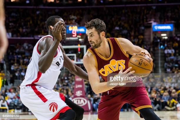 Pascal Siakam of the Toronto Raptors puts pressure on Kevin Love of the Cleveland Cavaliers during the second half at Quicken Loans Arena on November...
