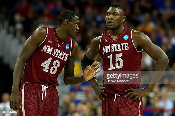Pascal Siakam speaks with Tshilidzi Nephawe of the New Mexico State Aggies in the first half against the Kansas Jayhawks during the second round of...