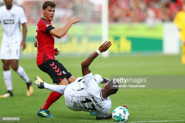 Pascal Stenzel of FC Freiburg and Kevin PrinceBoateng of Frankfurt during the Bundesliga match between SportClub Freiburg and Eintracht Frankfurt at...