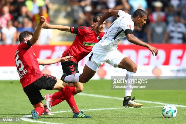 Pascal Stenzel of FC Freiburg Sebastien Haller of Frankfurt and Julian Schuster of FC Freiburg during the Bundesliga match between SportClub Freiburg...