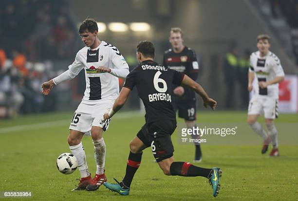 Pascal Stenzel of Freiburg and Aleksandar Dragovic of Leverkusen battle for the ball during the Bundesliga match between Bayer 04 Leverkusen and SC...
