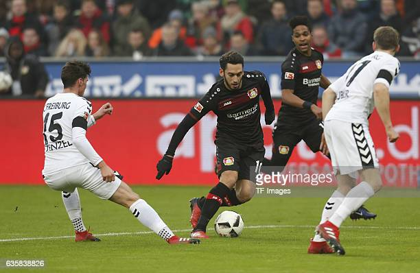 Pascal Stenzel of Freiburg and Hakan Calhanoglu of Leverkusen battle for the ball during the Bundesliga match between Bayer 04 Leverkusen and SC...