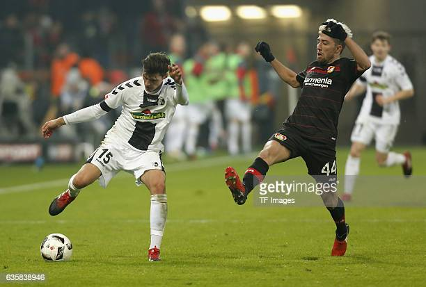 Pascal Stenzel of Freiburg and Kevin Kampl of Leverkusen battle for the ball during the Bundesliga match between Bayer 04 Leverkusen and SC Freiburg...