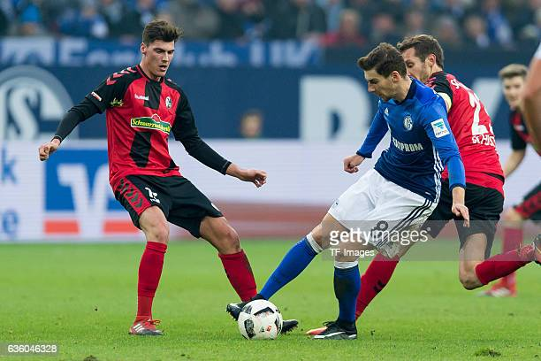 Pascal Stenzel of Freiburg and Leon Goretzka of Schalke battle for the ball during the Bundesliga match between FC Schalke 04 and SC Freiburg at...