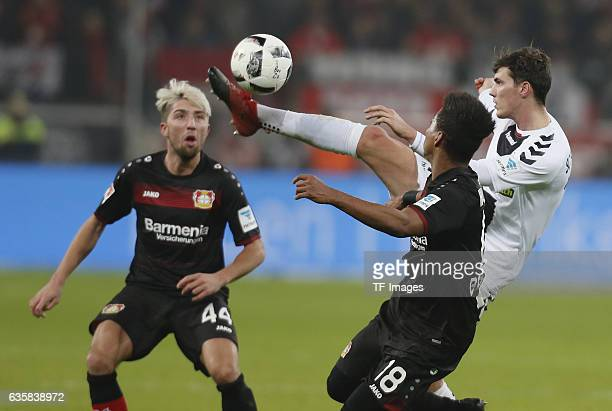 Pascal Stenzel of Freiburg and Wendell of Leverkusen and Kevin Kampl of Leverkusen battle for the ball during the Bundesliga match between Bayer 04...