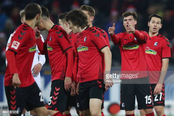 Pascal Stenzel of Freiburg directs the wall before a freekick during the Bundesliga match between SportClub Freiburg and Hamburger SV at...
