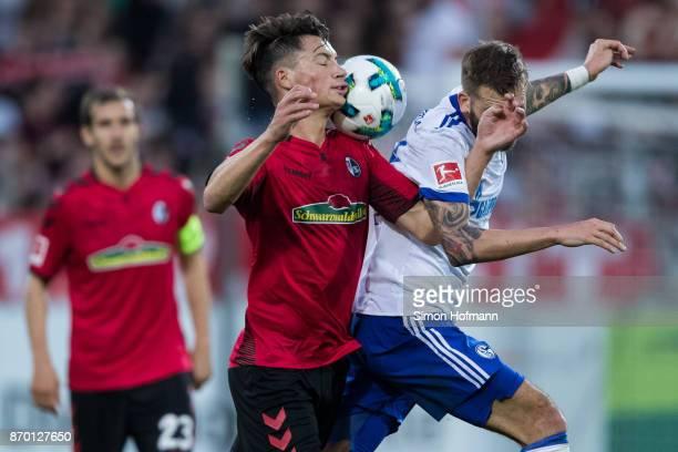 Pascal Stenzel of Freiburg jumps for a header with Daniel Caligiuri of Schalke during the Bundesliga match between SportClub Freiburg and FC Schalke...