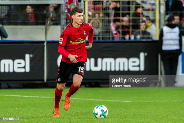 Pascal Stenzel of Freiburg passes the ball during the Bundesliga match between SportClub Freiburg and 1 FSV Mainz 05 at SchwarzwaldStadion on...