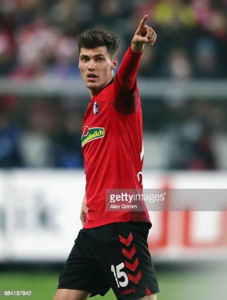 Pascal Stenzel of Freiburg reacts during the Bundesliga match between SportClub Freiburg and Hamburger SV at SchwarzwaldStadion on December 1 2017 in...