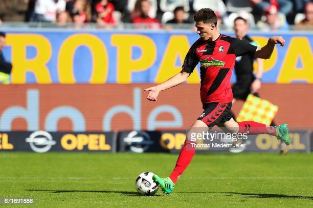 Pascal Stenzel of Freiburg scores during the Bundesliga match between SC Freiburg and Bayer 04 Leverkusen at SchwarzwaldStadion on April 23 2017 in...