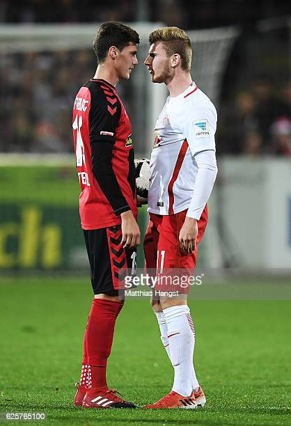 Pascal Stenzel of SC Freiburg faces off with Timo Werner of RB Leipzig during the Bundesliga match between SC Freiburg and RB Leipzig at...