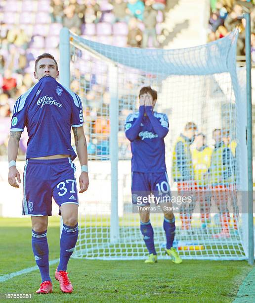Pascal Testroet and Daniel Nagy of Osnabrueck look dejected during the Third League match between between VfL Osnabrueck and MSV Duisburg at Osnatel...