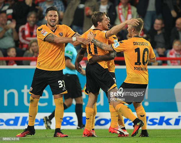 Pascal Testroet Andreas Lambertz and Marvin Stefaniak of SG Dynamo Dresden celebrate after scoring the 22 during the game between 1 FC Union Berlin...