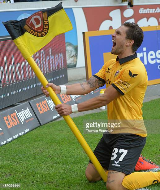 Pascal Testroet of Dresden celebrates after scoring the opening goal during the Third League match between SG Dynamo Dresden and Chemnitzer FC at...