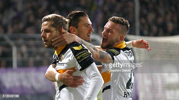 Pascal Testroet of Dresden celebrates scoring his team's first goal with teammates Justin Eilers and Fabian Holthaus during the third league match...