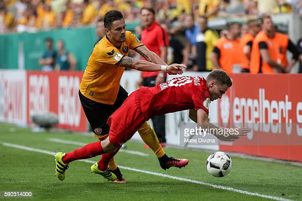 Pascal Testroet of Dresden competes for the ball with Benno Schmitz of Leipzig during the DFB Cup match between Dynamo Dresden and RB Leipzig at...