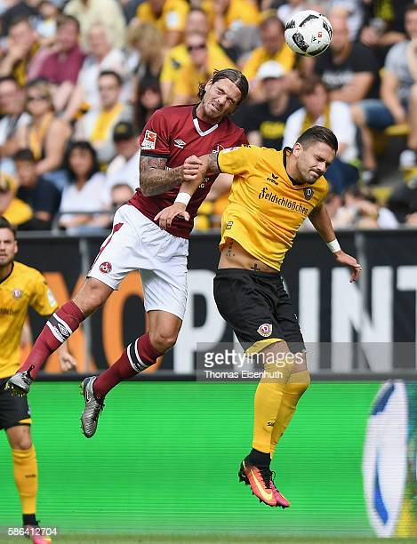 Pascal Testroet of Dresden is challenged by Davy Bulthuis of Nuernberg during the Second Bundesliga match between SG Dynamo Dresden and 1 FC...