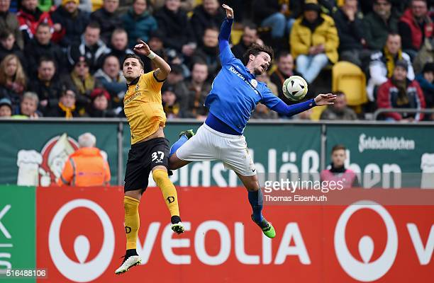 Pascal Testroet of Dresden is challenged by Dennis Erdmann of Rostock during the Third League match between SG Dynamo Dresden and FC Hansa Rostock at...