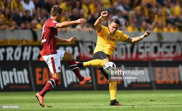 Pascal Testroet of Dresden is challenged by Jakub Sylvestr of Nuernberg during the Second Bundesliga match between SG Dynamo Dresden and 1 FC...