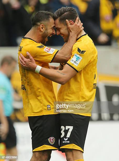 Pascal Testroet of Dresden jubilates with team mate Akaki Gogia after scoring the fived goal during the Second Bundesliga match between SG Dynamo...