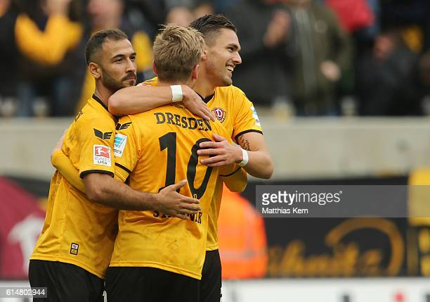 Pascal Testroet of Dresden jubilates with team mate Akaki Gogia and Marvin Stefaniak after scoring the fived goal during the Second Bundesliga match...