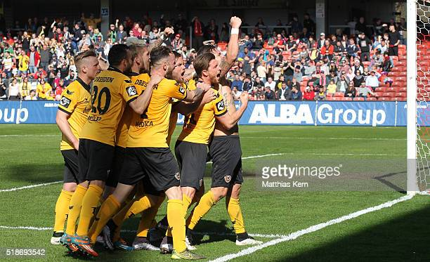 Pascal Testroet of Dresden jubilates with team mates after scoring the second goal during the third league match between FC Energie Cottbus and SG...
