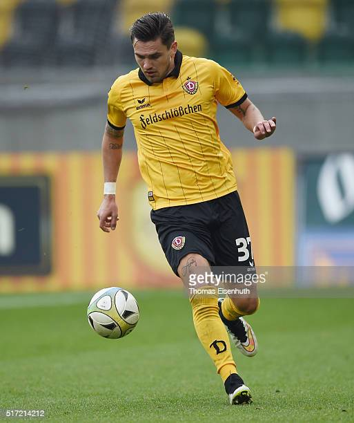 Pascal Testroet of Dresden plays the ball during the Third League match between SG Dynamo Dresden and FC Hansa Rostock at DDVStadion on March 19 2016...