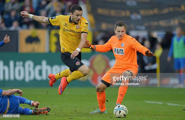 Pascal Testroet of Dresden scores his team's second goal against goalie Jan Glinker of Magdeburg during the Third League match between SG Dynamo...
