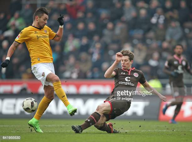 Pascal Testroet of Dynamo Dresden and Daniel Buballa of St Pauli battle for the ball during the Second Bundesliga match between FC St Pauli and SG...