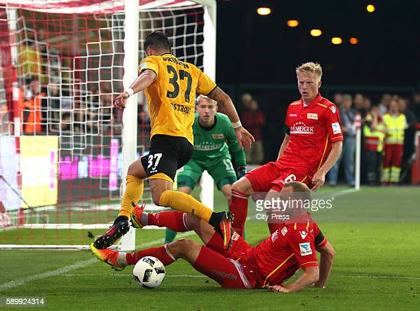 Pascal Testroet of SG Dynamo Dresden and Toni Leistner of 1 FC Union Berlin during the game between 1 FC Union Berlin and Dynamo Dresden on August 15...
