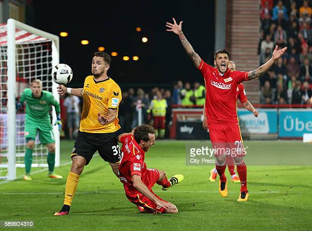 Pascal Testroet of SG Dynamo Dresden Stephan Fuerstner and Christopher Trimmel of 1 FC Union Berlin during the game between 1 FC Union Berlin and...