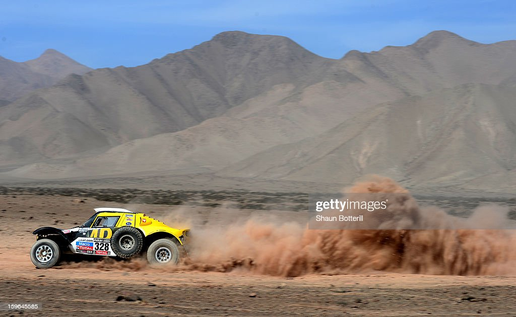 Pascal Thomasse and co-driver Pascal Larroque of team Buggy MD Rallye compete in stage 12 from Fiambala to Copiapo during the 2013 Dakar Rally on January 17, 2013 in Fiambala, Argentina.