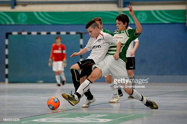 Pascal Tischler of Fuerth challenges Antonio Zarbo of Koeln during the DFB C Juniors Futsal Cup 3rd place match between SC Fortuna Koeln and SpVgg...