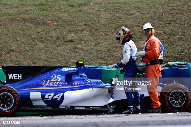 Pascal Wehrlein of Germany and Sauber F1 looks at his car after crashing during practice for the Formula One Grand Prix of Hungary at Hungaroring on...