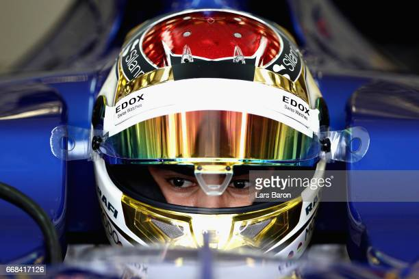 Pascal Wehrlein of Germany and Sauber F1 sits in his car in the garage during practice for the Bahrain Formula One Grand Prix at Bahrain...