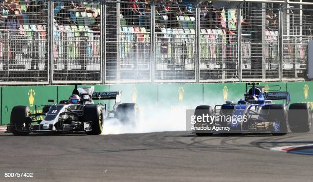 Pascal Wehrlein of Sauber F1 Team and Romain Grosjean of Haas F1 Team compete during the Azerbaijan Formula One Grand Prix at Baku City Circuit in...