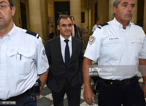 Pascal Wilhelm former authorised representative of the French L'Oreal heiress leaves the courthouse in Bordeaux western France flanked by police...