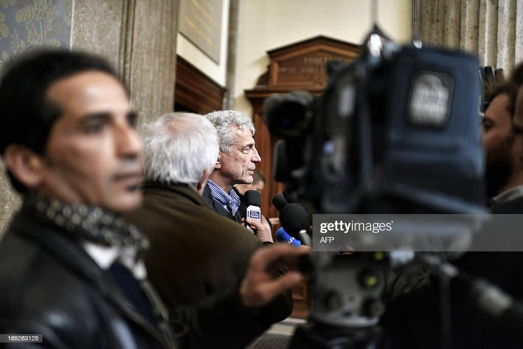 Pascal Winter (C), counsel for the plaintiff, answers journalists' questions in Lyon's criminal court, on April 2, 2013, on the opening day of Christophe Khider and Omar Top El Hadj's trial. They are judged for having escaped from jail using explosives and taking hostages two prison staffs. AFP PHOTO / JEFF PACHOUD