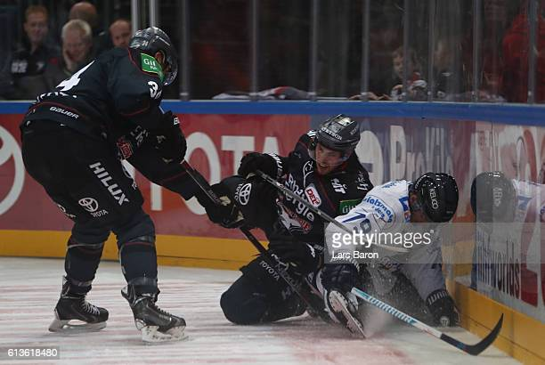 Pascal Zerressen of Koeln challenges Blaine Down of Iserlohn during the DEL match between Koelner Haie and Iserlohn Roosters at Lanxess Arena on...