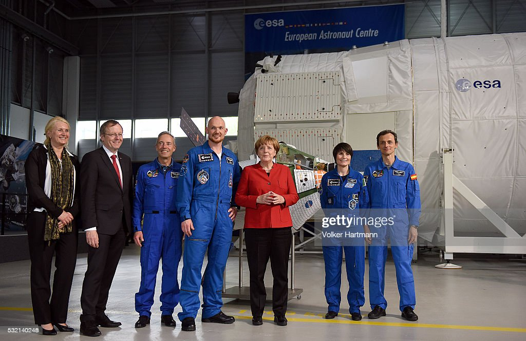 Pascale Ehrenfreund, ESA president Johann-Dietrich Woerner , astronaut Jean-Francoise Clervoy, astronaut <a gi-track='captionPersonalityLinkClicked' href=/galleries/search?phrase=Alexander+Gerst&family=editorial&specificpeople=5862799 ng-click='$event.stopPropagation()'>Alexander Gerst</a>, German Chancellor <a gi-track='captionPersonalityLinkClicked' href=/galleries/search?phrase=Angela+Merkel&family=editorial&specificpeople=202161 ng-click='$event.stopPropagation()'>Angela Merkel</a>, the astronaut Samantha Cristoforetti and the astronaut Pedro Duque (L-R) pose in the astronauts training hall during a visit of the of the European Astronauts Center (EAC) of the European Space Ageny (ESA) on May 18, 2016 in Cologne, Germany. Merkel is visiting the facilities, as well as the nearby German Center for Air and Space Travel (das Deutsche Zentrum fuer Luft- und Raumfahrt, or DLR) in order to promote Germany's participation in ESA's projects, which sees as important to climate change, energy and agricultural sector research.