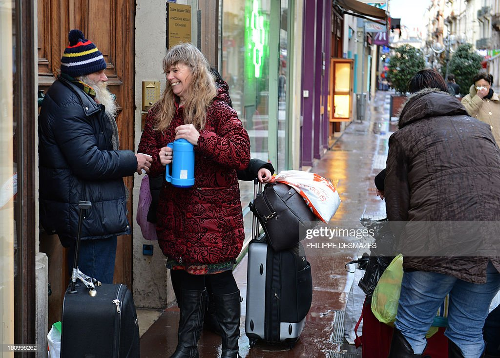 MOUTTET --- Pascale Madeleine (C) and four other 'marauders' distribute blankets, biscuits and soup to the homeless in the streets of Lyon on February 6, 2013. Most citizens' initiatives solicit admiration, but outings like this intended only for the 'native French' by extreme right-wing groups is creating a debate.